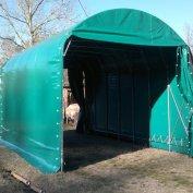 Struttura per ricovero autocarro trasporto legna coperto con telo in PVC ignifugo verde e testate scorrevoli