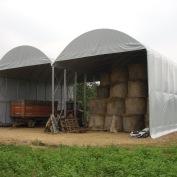 Struttura multipla composta da 2 strutture da mt. 7x15 coperte in telo PVC ignifugo per magazzino paglia e macchine agricole